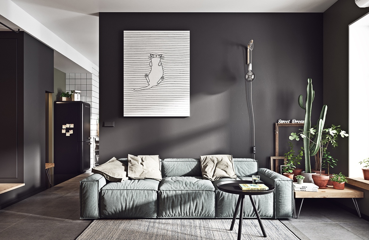 hipster-cat-painting-dark-living-room-couch-throw-pillows-simple-end-table-pots-plants-cactus-lamp