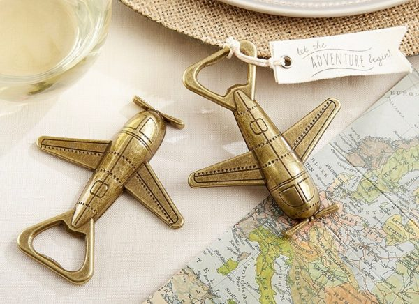 brass-look-bottle-openers-travel-themed-wedding-decorations-600x436